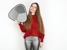 Spectacular blonde woman in red blouse silver leather pants posing in front of white wall. with grey card. Graceful girl gorgeous. Spectacular blonde lady in red Stock Photography