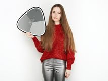 Spectacular blonde woman in red blouse silver leather pants posing in front of white wall. with grey card. Graceful girl gorgeous. Spectacular blonde lady in red Stock Photo