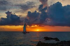 Free Spectacular Bright Red Sunset On The Sea With A Sailboat Visible Royalty Free Stock Photography - 205976057