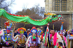 Spectacular carnival mummers and dragon Stock Photo