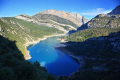 Canelles reservoir and Montrebei gorge, Catalonia. Spectacular cliff with a wooden walkway to be able to go down to a turquoise river. Montrebei Catalonia royalty free stock photo