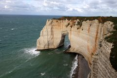 Spectacular cliffs and a natural arch Stock Images