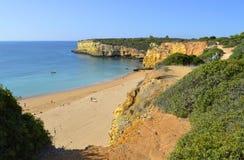 Spectacular cliffs on Senhora Da Rocha Nova Beach Royalty Free Stock Images