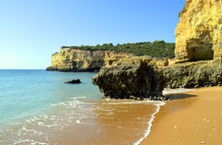 Spectacular cliffs on Senhora Da Rocha Nova Beach Royalty Free Stock Image