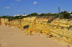 Spectacular cliffs on Senhora Da Rocha Nova Beach Stock Photos