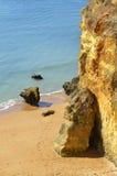 Spectacular cliffs on Senhora Da Rocha Nova Beach Stock Photography