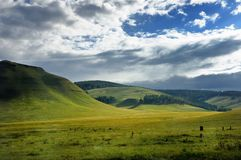 Spectacular clouds over smooth grass hills and steppe in Khakassia, East Siberia, Russia. stock images