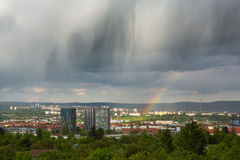Spectacular clouds and rainbow over city Royalty Free Stock Photography