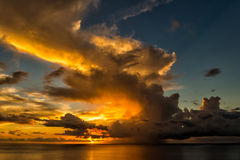 Spectacular clouds at sunset above the sea Stock Photo
