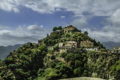 Spectacular colorful scenic view of old Savoca nestled on an hill in Sicily. Spectacular and colorful scenic view of old Savoca, a town nestled on an hill Sicily stock photos