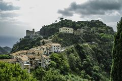 Spectacular colorful scenic view of the old town of Savoca in Sicily. Spectacular and colorful scenic view of green lustrus hills and the old town of Savoca, a royalty free stock photo