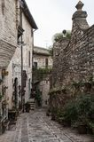 Spectacular colorful traditional italian medieval alley in the historic center of beautiful little town of Spello Perugia Royalty Free Stock Photos