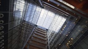 Cool creative urban high-rise building with glass facade and balconies. stock footage