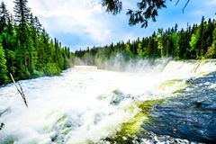 The spectacular Dawson Falls in Wells Gray Provincial Park, BC, Canada. Large snow melt in the Cariboo Mountains creates spectacular water flow of Dawson Falls Royalty Free Stock Image