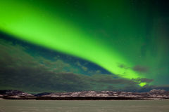 Intense band of Northern Lights in northern winter Royalty Free Stock Images