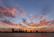 Spectacular diverging clouds & Bahrain skyline on sunset Royalty Free Stock Photo