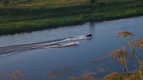 Extreme water sport. The man engages in water skiing on the Volga river in Rzhev. stock footage