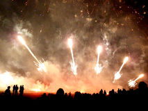 Spectacular fireworks 1. Spectacular fireworks silhouettting the crowd Royalty Free Stock Photography
