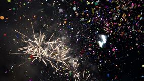 Spectacular fireworks display with confetti. New Year celebration colorful fireworks. Glowing, multicolored and sparkle firework o stock video