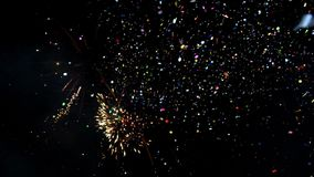 Spectacular fireworks display with confetti. New Year celebration colorful fireworks. Glowing, multicolored and sparkle firework o stock video footage