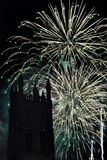 Spectacular fireworks display with a tower in the foreground Stock Photography