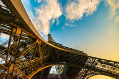 Amazing unique colourful wide angle shot of the Eiffel tower from below, showing all pillars. Stock Photo