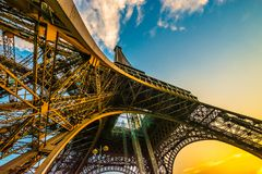 Spectacular unique colourful wide angle shot of the Eiffel tower from below, showing all pillars. Spectacular fish eye wide angle shot showing the Eiffel tower royalty free stock photo