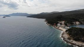 Spectacular footage of flying over picturesque fishing village. stock footage