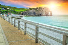 Spectacular gravel beach and magical colorful sunset Etretat, Normandy, France stock photo