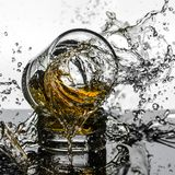 Spectacular High Speed shot of whiskey Glasees breaking royalty free stock image