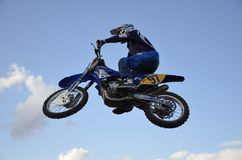 The spectacular jump moto racer on a motorcycle Stock Images