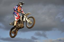 The spectacular jump moto racer on a motorcycle Stock Photos