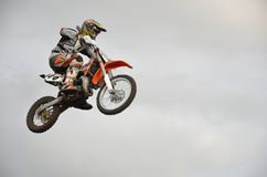 The spectacular jump moto racer on a motorcycle Royalty Free Stock Image