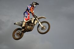 The spectacular jump moto racer on a motorcycle Royalty Free Stock Photos