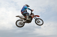 The spectacular jump motocross racer Royalty Free Stock Image