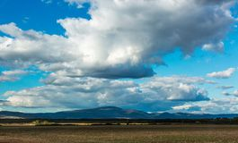 Spectacular landscape of Hungarian Tokay region. Field, mountains and dramatic cloudy sky royalty free stock photo