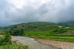 Spectacular landscape of mountain valley with river and rice terraces stock photography