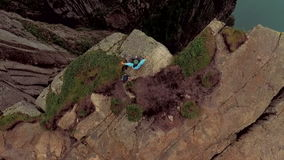 Spectacular landscape of wildlife. Girl on the edge of a cliff. Trolltunga. Spectacular landscape of wildlife. Girl on the edge of a cliff Trolltunga. Norway stock footage