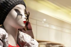 Spectacular mannequin in the store with bright lips and long eyelashes stock photos