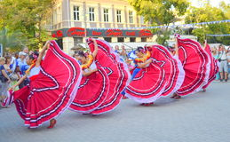 Spectacular Mexican dance. Mexican women dancing at Varna square,Bulgaria during Parade of 23rd International Folklore Festival participants.August 3rd 2014 Stock Image
