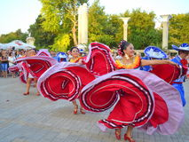 Spectacular Mexican dancers. Spectacular Mexican women dancers at Varna square,Bulgaria during street parade of 23th International Folklore Festival participants Stock Photography