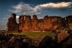 Spectacular moody sunset view of Penrith Castle in Cumbria. United Kingom stock photos