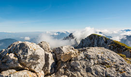 Spectacular mountain panorama, mists slowly starting to rise. Royalty Free Stock Photo