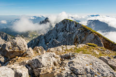 Spectacular mountain panorama, mists slowly starting to rise. Stock Image