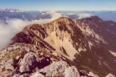 Spectacular mountain panorama, mists slowly starting to rise. Royalty Free Stock Photography