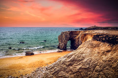 Spectacular natural cliffs and stone arch Arche de Port Blanc an Stock Photo