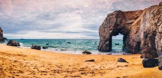 Spectacular natural cliffs and stone arch Arche de Port Blanc an Stock Photos