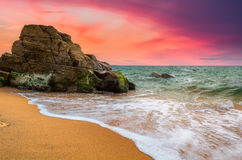 Spectacular natural cliffs and stone arch Arche de Port Blanc an Royalty Free Stock Images