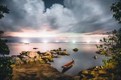 Spectacular night shot on a koh-tao beach thailand with a moored boat stock photography