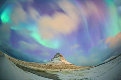 Spectacular northern lights appear over Mount Kirkjufell Royalty Free Stock Photo